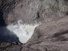 the crater inside constantly belches white sulphurous smoke