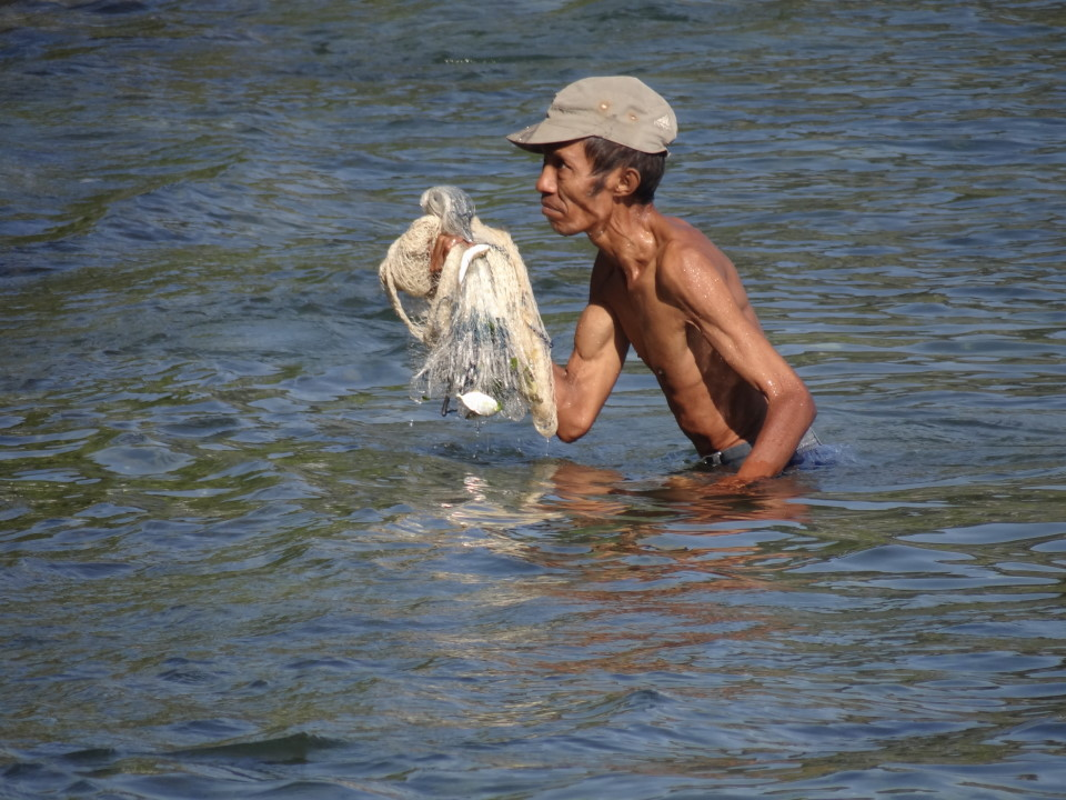 fishing man, Dili